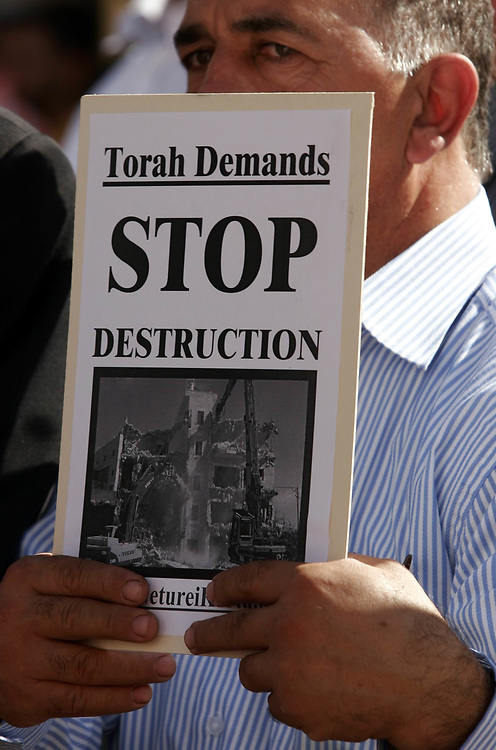 An Arab-Israeli citizen from East Jerusalem protests along with some 500 Palestinians against the Jerusalem municipality's house demolition policy in Safra Square, Jerusalem's city hall public square, on November 6, 2007.