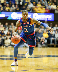 Jan 15, 2018; Morgantown, WV, USA; Kansas Jayhawks guard Lagerald Vick (2) dribbles past a defender during the first half against the West Virginia Mountaineers at WVU Coliseum. Mandatory Credit: Ben Queen-USA TODAY Sports