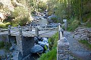 Bridge crossing the River Rio Poqueira gorge valley, High Alpujarras, Sierra Nevada, Granada Province, Spain