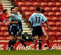 Photo. Jed Wee, Digitalsport<br /> Middlesbrough v Southampton, Barclays Premiership, 20/03/2005.<br /> Southampton's Graeme le Saux (L) celebrates with Nigel Quashie.