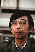 Portrait of Kazuo Ukita, 45. Kodaira City, Japan. Material World Project. The Ukita family lives in a 1421 square foot wooden frame house in a suburb northwest of Tokyo called Kodaira City.