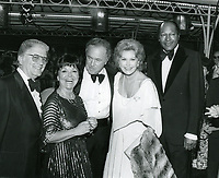 """1979 (L to R) William Hertz, Councilwoman Peggy Stevenson, Ted Mann, Rhonda Fleming & Mayor Tom Bradley at the movie premiere of """"Hurricane"""" at Mann's Chinese Theater"""