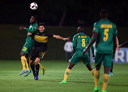 Danny Phiri of Golden Arrows and Roland Putsche of Cape Town City both jump for the ball during the 2016 Premier Soccer League match between Golden Arrows and Cape Town City FC held at the Prince Magogo Stadium in Durban, South Africa on the 14th September 2016<br /> <br /> Photo by:   Steve Haag / Real Time Images