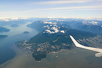Air Canada Embraer 190 flying over North Vancouver and Horseshoe Bay