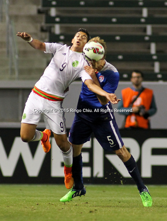 United States' Walker Zimmerman #5 and Mexico's ngel Zaldivar #9 fight for a ball during a men's national team international friendly match, April 22, 2015, at StubHub Center in Carson, California. United States won 3-0. (Photo by Ringo Chiu/PHOTOFORMULA.com)