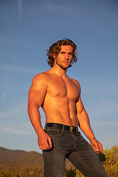 hot shirtless muscular man outdoors at sunset