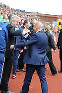 Stoke city manager Mark Hughes (l) greets Ian Holloway, the Palace manager before k/o.  Barclays Premier league match, Stoke city v Crystal Palace at the Britannia Stadium in Stoke on Trent on Saturday 24th August 2013. pic by Andrew Orchard , Andrew Orchard sports photography,