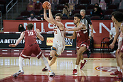Southern California Trojans guard Drew Peterson (13) splits defenders Stanford Cardinal forward Spencer Jones (14) and forward Max Murrell (10)during an NCAA men's basketball game, Wednesday, March 3, 2021, in Los Angeles. USC defeated Stanford 79-42. (Jon Endow/Image of Sport)