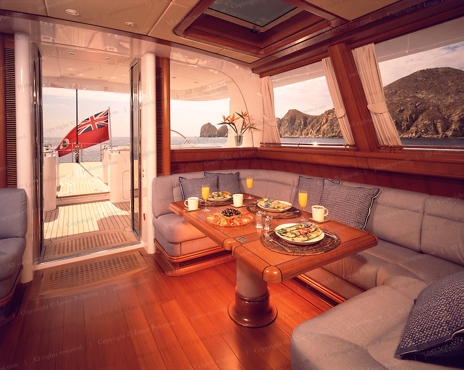 Hyperion's deckhouse windows are hurricane-proof, provide UV protection and can come completely down to create an alfresco atmosphere and are air-sealed  Portside deckhouse photographed near Cabo San Lucas