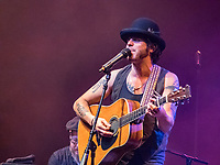 """OLYMPUS DIGITAL CAMERA In 2015 The Boston Globe: """"Slim is more reflective now, his banjo-driven rock-folk-pop hybrid increased in artistry and depth."""" """"With a high-pitched, almost Neil Young timbre to his voice, Slim sings that 'I'm going through changes now' – said changes amounting to a highly listenable rebirth."""""""