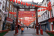 Red lanterns on Gerrard Street ready for Chinese New Year at Chinatown as the national coronavirus lockdown three continues on 3rd March 2021 in London, United Kingdom. With the roadmap for coming out of the lockdown has been laid out, this nationwide lockdown continues to advise all citizens to follow the message to stay at home, protect the NHS and save lives, and the streets of the capital are quiet and empty of normal numbers of people.