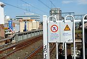 Signage on railway station platform. Burwood, Sydney, Australia