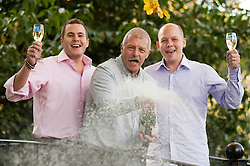 Family Syndicate, Brothers Mark (left) and Ian (right)  and Dad Les Holmes all from Doncaster collect £6,722,094 in National Lottery Win.27 October 2010 .Images © Paul David Drabble