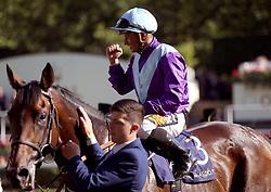 Jockey Silvestre De Sousa celebrates winning the Duke of Edinburgh Stakes on Dash of Spice during day four of Royal Ascot at Ascot Racecourse.