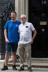 London, UK. 20th July, 2021. NHS Wales nurse Matthew Tovey poses outside 10 Downing Street with former Labour Party leader Jeremy Corbyn after presenting his NHSPay15 petition signed by over 800,000 people calling for a 15% pay rise for NHS workers. At the time of presentation of the petition, the government was believed to be preparing to offer NHS workers a 3% pay rise in 'recognition of the unique impact of the pandemic on the NHS'.