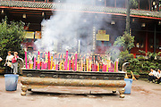 China, Sichuan Province, Mount Emei Wannian Temple lighting candles