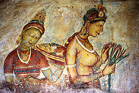 Portraits of Apsaras (celestial nymphs) and attendents feature in the fresco gallery of Sigirya, Sri Lanka..