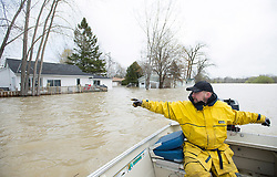 Chris Amerides points to a house surrounded by floodwaters as he makes his way home in a boat along the Rigaud river west of Montreal, Monday, May 8, 2017, following flooding in the region. Photo by Graham Hughes /The Canadian Press/ABACAPRESS.COM