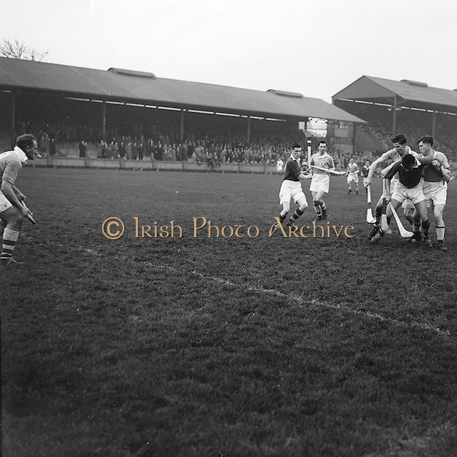 Dublin players outnumber a Cork player during the National Hurling League, Cork v Dublin in Croke park on the 15th November 1953.
