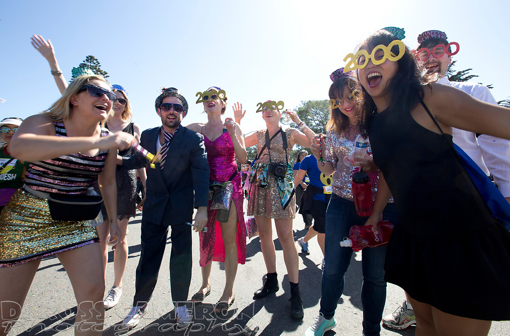 Revelers at the 105th running of the Bay to Breakers 12k honor the late singer/songwriter Prince by partying like it's 1999, Sunday, May 15, 2016 in San Francisco. The 7.42-mile race from San Francisco Bay to the Pacific Ocean, which attracts a field of tens of thousands of runners, from elite runners to weekend warriors, some clad in costume and some in nothing at all. (Photo by D. Ross Cameron)