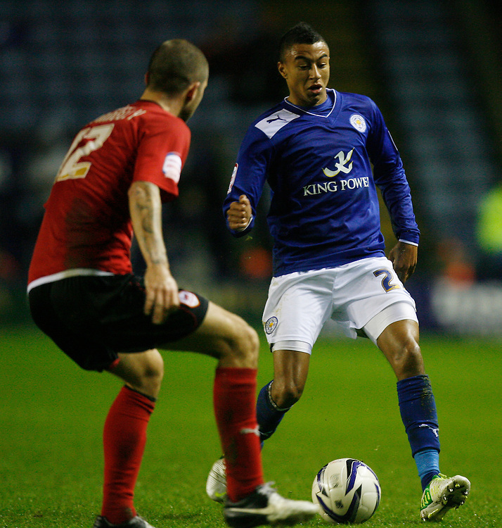Leicester's Jesse Lingard (R) and Cardiff City's Matthew Connolly in action   ..Football - npower Football League Championship - Leicester City v Cardiff City - Saturday 22nd December 2012 - The King Power Stadium - Leicester..© CameraSport - 43 Linden Ave. Countesthorpe. Leicester. England. LE8 5PG - Tel: +44 (0) 116 277 4147 - admin@camerasport.com - www.camerasport.com