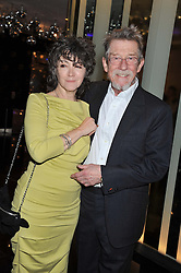 JOHN HURT and ANWEN REES MEYERS at W London - Leicester Square for the Liberatum Cultural Honour in Spice Market for John Hurt, CBE in association with artist Svetlana K-Lié on 10th April 2013.