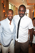 24 June 2010- Miami Beach, Florida- l to r: Jeff Friday and Idris Elba at the The 2010 American Black Film Festival Founder's Brunch held at Emeril's on June 24, 2010. Photo Credit: Terrence Jennings/Sipa