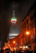 La Mole Antonelliana cinta dal tricolore in occasione della Notte Tricolore per le celebrazioni per il 150° dell'Unità di Italia a Torino..