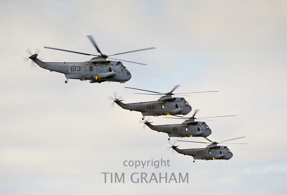 Sikorsky SH-3 twin-engined helicopters in flight above San Diego in California, USA (in UK known as Sea King helicopters, Sea Kings)