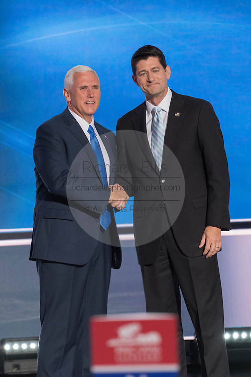 Gov. Mike Pence is introduced by Speaker Paul Ryan as he walks onstage to addresses delegates and formally accept the nomination as GOP Vice Presidential  candidate during the third day of the Republican National Convention July 20, 2016 in Cleveland, Ohio.