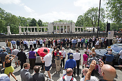 © London News Pictures. 28/06/2012.  London, UK. Members of the public gather in hundreds to watch as HRH Queen Elizabeth II unveils a new £3.5m Bomber Command Memorial in Green Park, London dedicated to the 55,573 airmen who died in the Second World War. The pavilion, made of Portland Stone stands at over 8m tall with an open roof. The entrance is made from melted down aluminium sections of a Halifax bomber shot down during the war and in which all seven of the crew were killed. The memorial includes inscriptions from Winston Churchill. Photo credit: Ben Cawthra/LNP