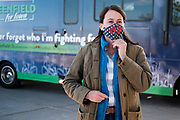"27 OCTOBER 2020 - MARSHALLTOWN, IOWA: THERESA GREENFIELD adjusts her face mask during a campaign visit to the UnityPoint Health complex in Marshalltown. Greenfield, the Democratic candidate for US Senate, visited UnityPoint Health - Marshalltown Medical Park in Marshalltown, about 55 miles from Des Moines, and talked to administators and local officials about jobs at the medical center and the need for rural healthcare. It was a part of her ""Jobs That Need to Get Done"" tour and Get Out the Vote efforts before the Nov. 3 election. Greenfield is running against incumbent US Senator Joni Ernst, a Republican.             PHOTO BY JACK KURTZ"