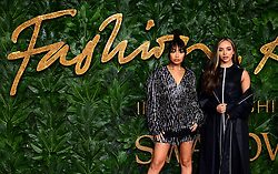 Leigh-Anne Pinnock and Jade Thirlwall (right) of Little Mix attending the Fashion Awards in association with Swarovski held at the Royal Albert Hall, Kensington Gore, London.