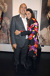 GILLES DYAN and his wife FLORENCE he is chairman of the Opera Gallery at a private view of paintings by Lita Cabellut and Russian artist Yuri Kuper at Opera Gallery, 134 New Bond Street, London on 2nd April 2008.<br /><br />NON EXCLUSIVE - WORLD RIGHTS
