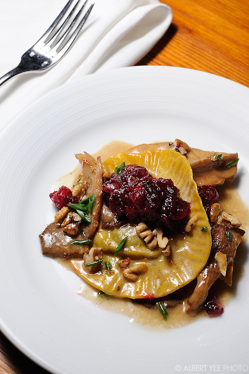 Mushroom raviolo (egg yolk, homemade ricotta and portobello duxelles) with pickled cranberries, oyster mushroom and hickory nuts<br /> <br /> Russet for Grid Magazine<br /> <br /> December 19. 2013