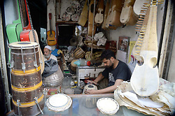 October 3, 2018 - Pakistan - PESHAWAR, PAKISTAN, OCT 02: Shopkeepers busy in repairing musical instruments to earn .their livelihood for support his families, at workplace in Peshawar on Tuesday, October 02, .2018. (Credit Image: © PPI via ZUMA Wire)