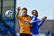 Cambridge United Defender, Greg Taylor (2) gets to the ball ahead of Portsmouth Forward, Nicke Kabamba (15) during the EFL Sky Bet League 2 match between Portsmouth and Cambridge United at Fratton Park, Portsmouth, England on 22 April 2017. Photo by Adam Rivers.