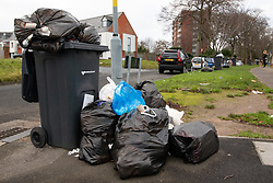 © Licensed to London News Pictures. 15/01/2019. Birmingham, West Midlands UK. Pictured, Rubbish stacked on the kerbside in Wallbank Road, Alum Rock. The Birmingham Bin Strike enters a third week and large piles of uncollected rubbish are starting to appear on the streets of inner City Birmingham. The Refuse collectors took strike action in 2018 and forced a change of Council Leadership. Residents have complained of seeing rats and white worms outside their houses. Photo credit: Dave Warren/LNP