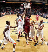 Nov 6, 2010; Charlottesville, VA, USA; Roanoke College Papa Fall (43) reaches for a rebound in front of Virginia Cavaliers KT Harrell (24) Saturday afternoon in exhibition action at John Paul Jones Arena. The Virginia men's basketball team recorded an 82-50 victory over Roanoke College.