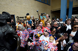 Royal fans celebrate outside the Lindo Wing at St Mary's Hospital in Paddington, London after the news that the Duchess of Cambridge has given birth to a son.