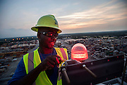 Ship to shore crane maintenance personnel change a light at the Georgia Ports Authority Garden City Terminal, Thursday, August 14, 2014, in Savannah, Ga.  (GPA Photo/Stephen B. Morton)