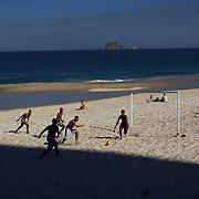 Locals play beach football during the late afternoon sunshine at Sao Conrado beach, Rio de Janeiro,  Brazil. 8th July 2010. Photo Tim Clayton..