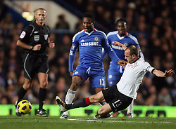 10.11.2010, Stamford Bridge, London, ENG, PL, FC Chelsea vs FC Fulham, im Bild Fulham's Danny Murphy (Captain) slide tackles Mikel John Obi of Chelsea   during Chelsea fc vs  Fulham fc for the EPL at Stamford Bridge in London on 10/11/2010. EXPA Pictures © 2010, PhotoCredit: EXPA/ IPS/ Marcello Pozzetti +++++ ATTENTION - OUT OF ENGLAND/UK +++++