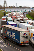 Lorries line up due to customs delays at the entrance of the Eurotunnel, Cheriton, Folkestone, Kent. United Kingdom on the 18th of December 2020. The Channel Tunnel is a 50.45-kilometre rail tunnel linking Folkestone, Kent, in the United Kingdom, with Coquelles, Pas-de-Calais, near Calais in northern France, beneath the English Channel.  (photo by Andrew Aitchison / In pictures via Getty Images)