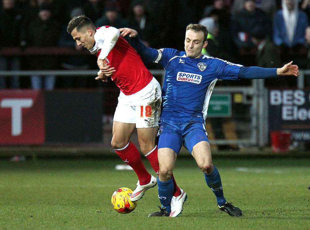 Fleetwood Town's Antoni Sarcevic goes down under the challenge from Oldham Athletic's Liam Kelly<br /> <br /> Photographer Rich Linley/CameraSport<br /> <br /> Football - The Football League Sky Bet League One - Fleetwood Town v Oldham Athletic - Saturday 17th January 2015 - Highbury Stadium - Fleetwood<br /> <br /> © CameraSport - 43 Linden Ave. Countesthorpe. Leicester. England. LE8 5PG - Tel: +44 (0) 116 277 4147 - admin@camerasport.com - www.camerasport.com