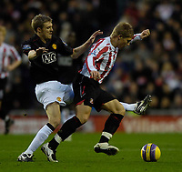Photo: Jed Wee/Sportsbeat Images.<br /> Sunderland v Manchester United. The FA Barclays Premiership. 26/12/2007.<br /> <br /> Manchester United's Darren Fletcher (L) sticks out a foot to try to dispossess Sunderland's Martyn Waghorn.