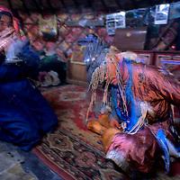 MONGOLIA, Darhad Valley. Shaman (Umgan) amidst a trance after dancing, chanting and beating a drum to invoke spirits.