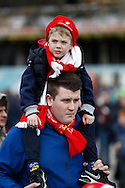 A Liverpool fan and a youngster walk to the match. Capital One Cup Final, Liverpool v Manchester City at Wembley stadium in London, England on Sunday 28th Feb 2016. pic by Chris Stading, Andrew Orchard sports photography.