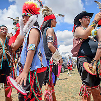 080214       Cable Hoover<br /> <br /> Members of the Hopi Apache Dancers from Shungopavi, Ariz. help each other with their regalia and makeup as before performing at the Ramah Navajo Fair Saturday in Pine Hill.