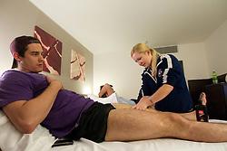 Ziga Pavlin and Physiotherapist Manca Marc of Slovenian National Ice Hockey team in a massage room in the hotel Holiday Inn at IIHF 2011 World Championship Slovakia, on May 4, 2011 in Bratislava, Slovakia. (Photo By Vid Ponikvar / Sportida.com)